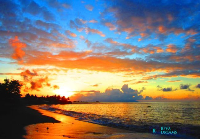 Sunset over the sea at the Duplex Matavai, stay at the discovery of the island of Tahiti, French Polynesia