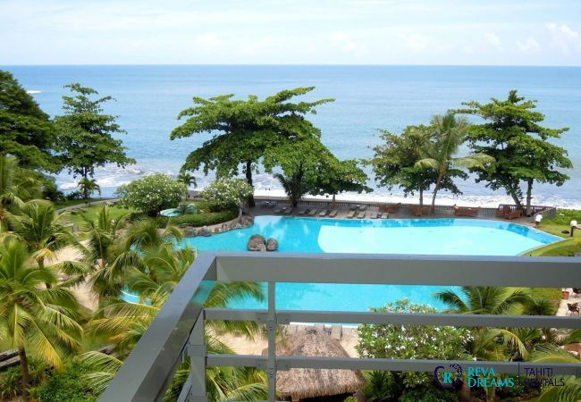 Terrace view of the Duplex Matavai, swimming pool, sea and coconut trees, vacation rentals in Arue, Tahiti