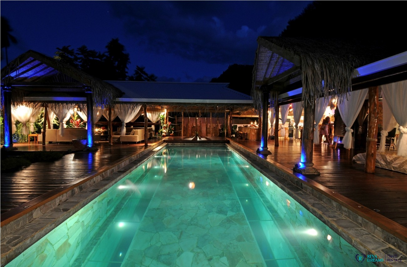 The large swimming pool of the Villa Tiahura at night, stays and trips by the seaside in French Polynesia