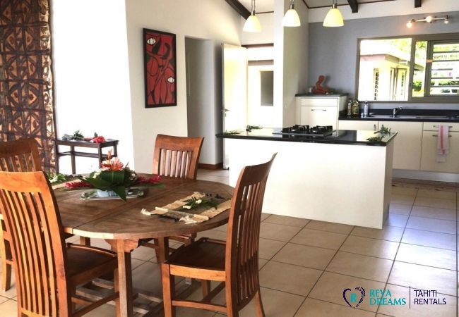 Modern, open-plan kitchen and dining area in the Villa Vahinera Dream holiday let, Tahiti