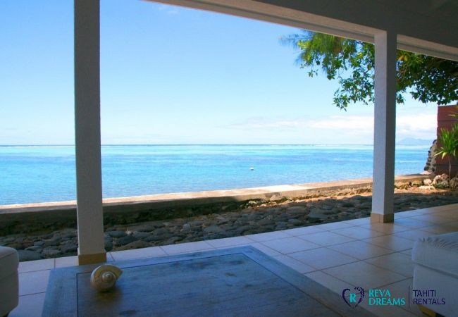 Shaded terrace with stunning views over the turquoise lagoon bordering Tahiti