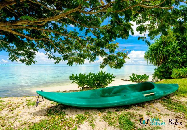 Kayak and beach at the Fare Tiki Dream, on Moorea island, dream holiday