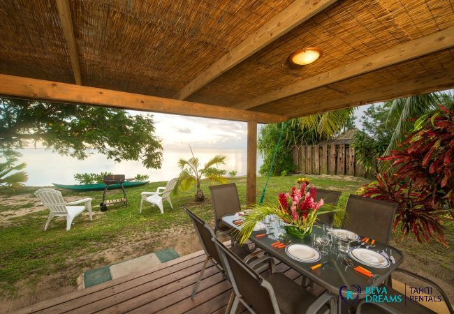 Outdoor dining terrace and barbecue, Fare Tiki Dream garden on Moorea Island, French Polynesia