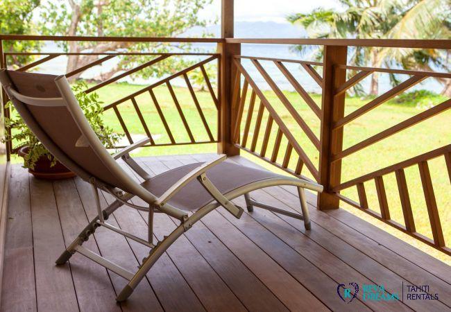 Shaded terrace and deckchair at Villa Tehere Dream, on the paradisal island of Tahaa, French Polynesia