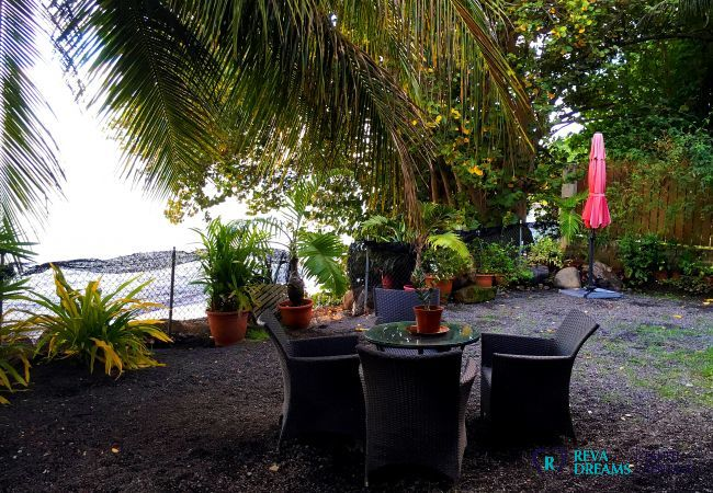 Outdoor dining in the garden area of Fare Ere Ere luxury vacation rental on Tahiti island