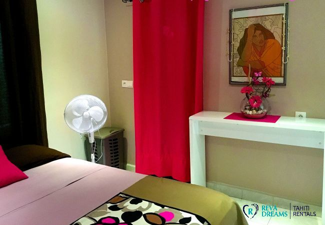 Charming floral interiors of the bedroom in Fare Ere Ere, peaceful vacations in Arue, Tahiti Island